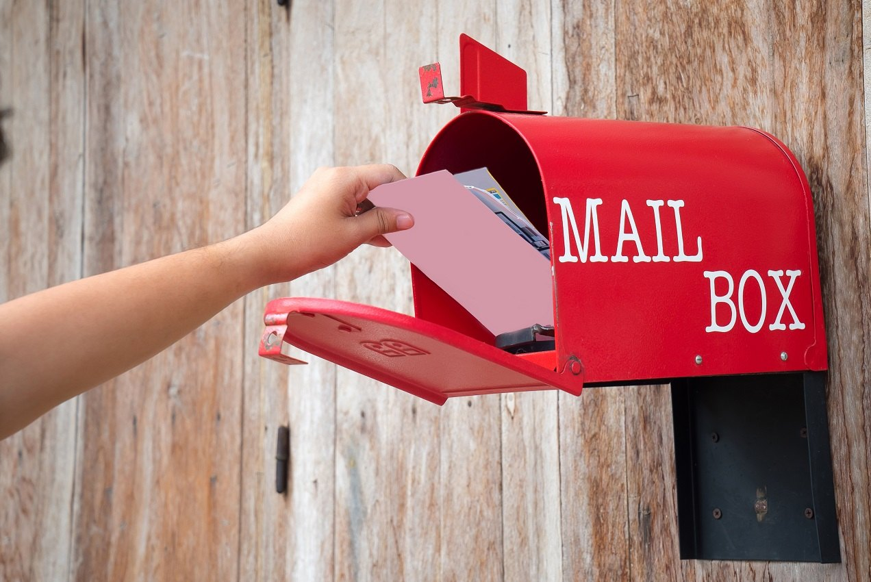 getting mail and postcard from red mail box